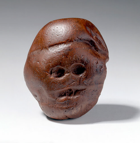 Three-million-year-old Makapansgat Pebble from South Africa. Perhaps the most ancient art object in the world. It is said to have been carried over a distance of four kilometers by Australopithecus. The Makapansgat Pebble is held at the University of Witwatersrand, South Africa.